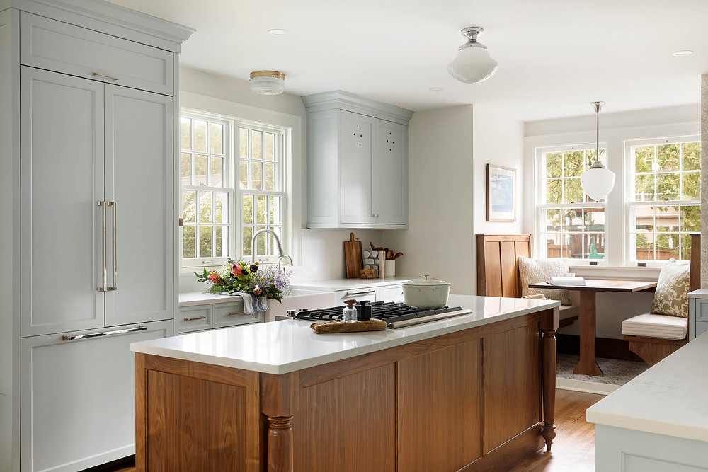Charming Colonial kitchen renovation with blue custom cabinetry, walnut island and built in breakfast booth, vintage lighting and quartz countertops