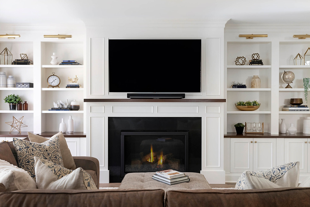Fireplace built in bookcases with wood top and mantle and custom millwork