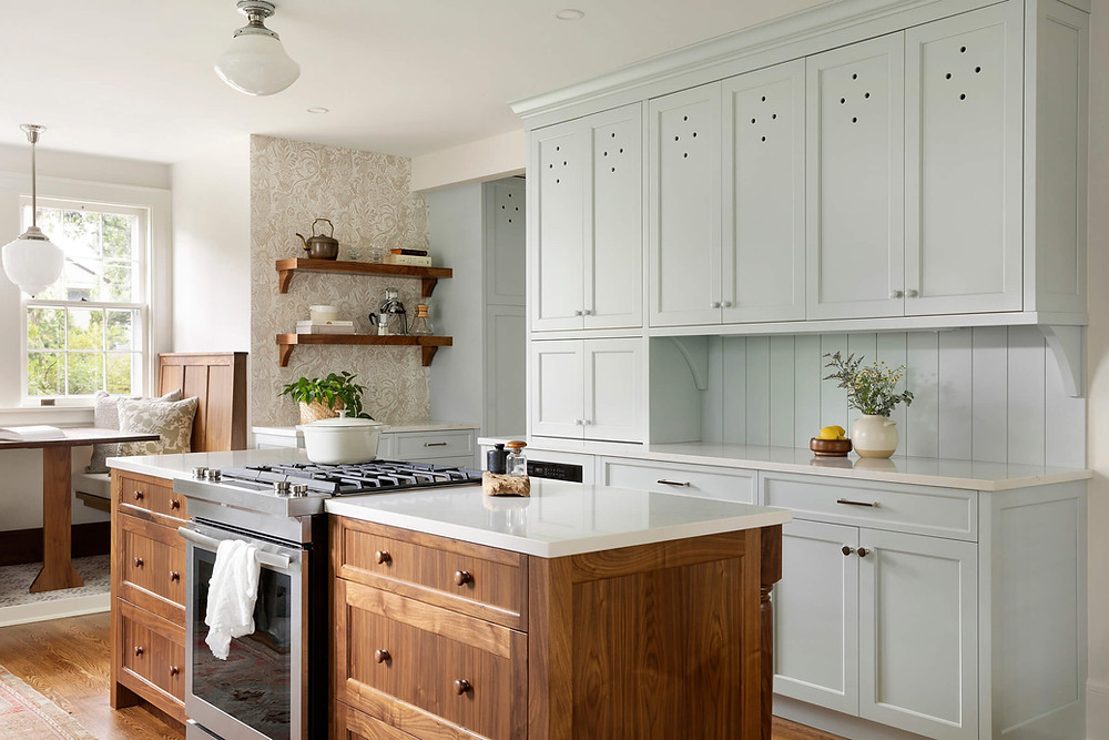 English Colonial inspired custom kitchen with upper larder vent hole cabinet details, walnut island with walnut knobs