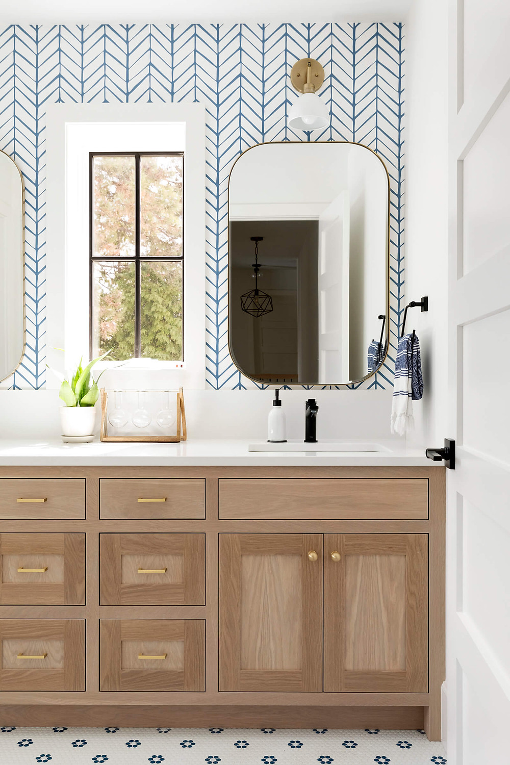 double vanity, white oak vanity, kids bathroom, flower tile, chevron blue wallpaper, gold hardware, brass mirror, rectangle mirror, kids room