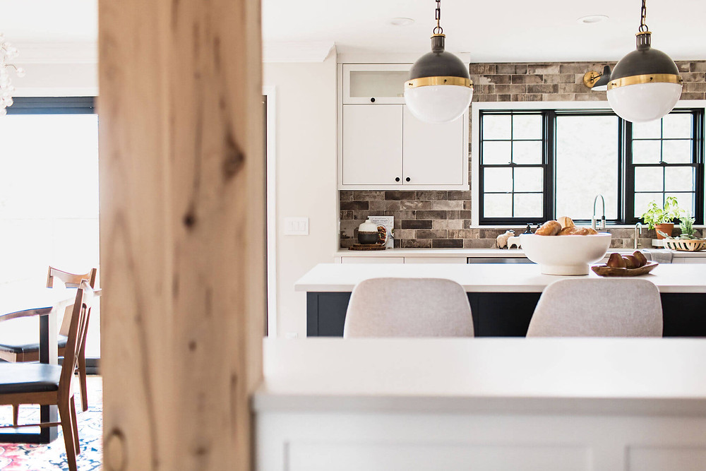 Contemporary industrial style kitchen renovation with reclaimed white oak wrapped support post, tumbled brick backsplash