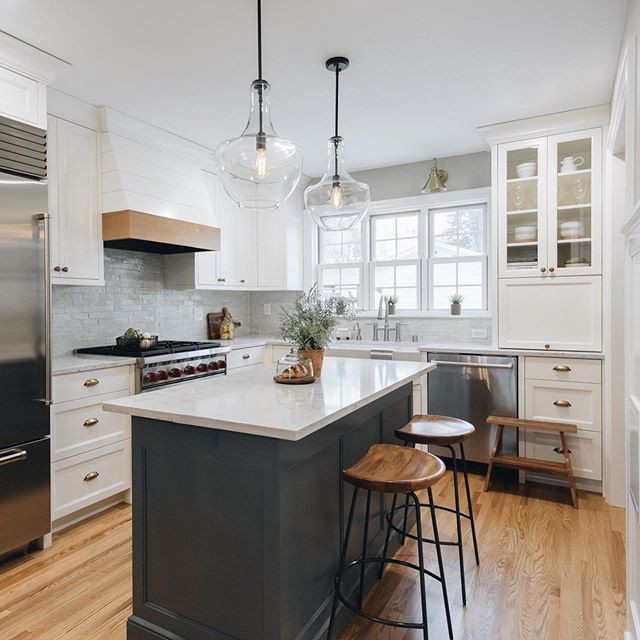 Colonial kitchen remodel, white cabinetry with contrasting blue painted kitchen island.