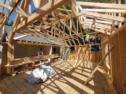 Framing, trusses for second story addition.