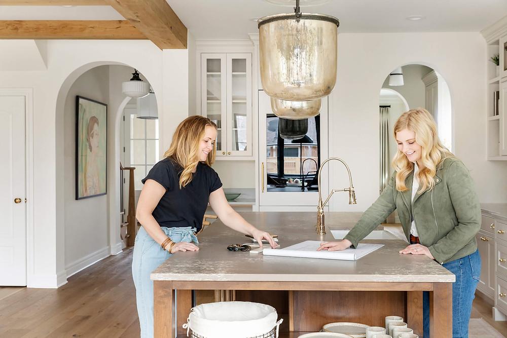 Interior designers planning a kitchen design on a kitchen island