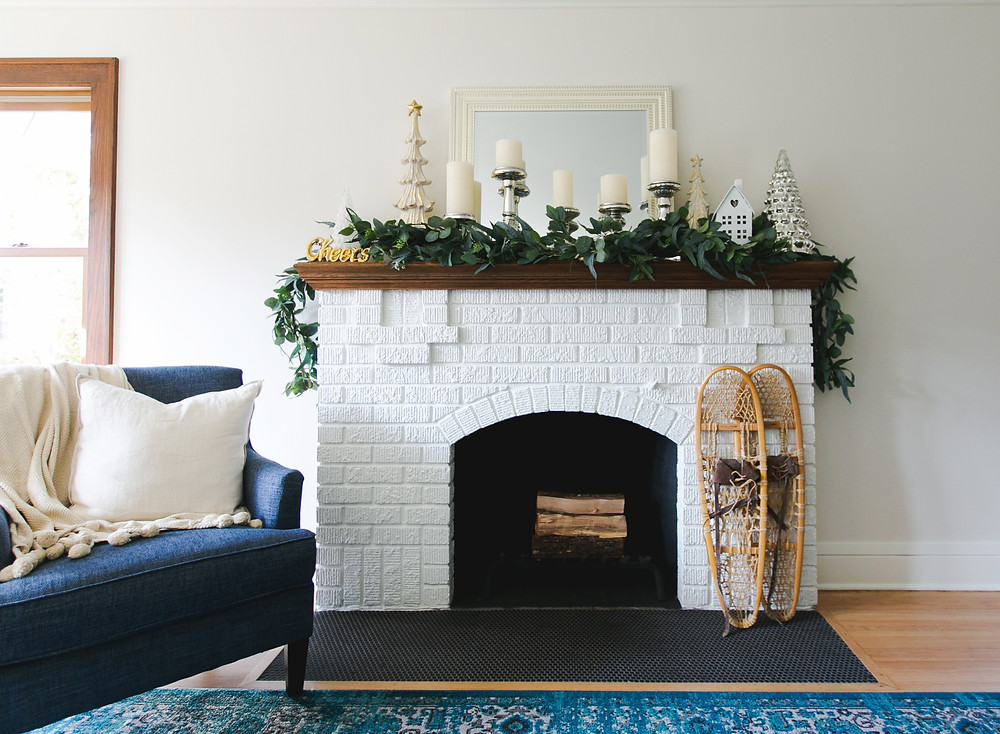 White painted fireplace with holiday decorated mantel