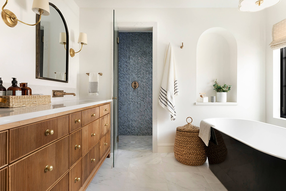Owner's bathroom showcasing all stone tile, using three different patterns featuring texture, color and contrast.