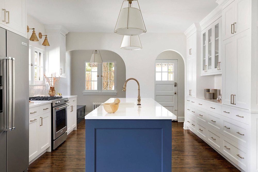 Custom white and blue cabinetry.