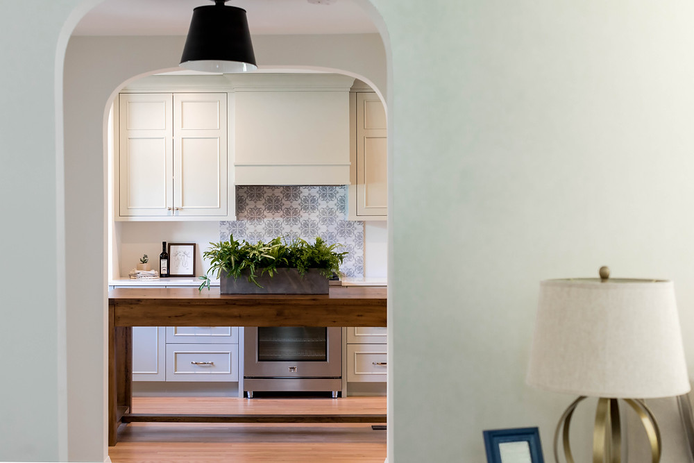 Outside the box with painted cabinetry other than white.