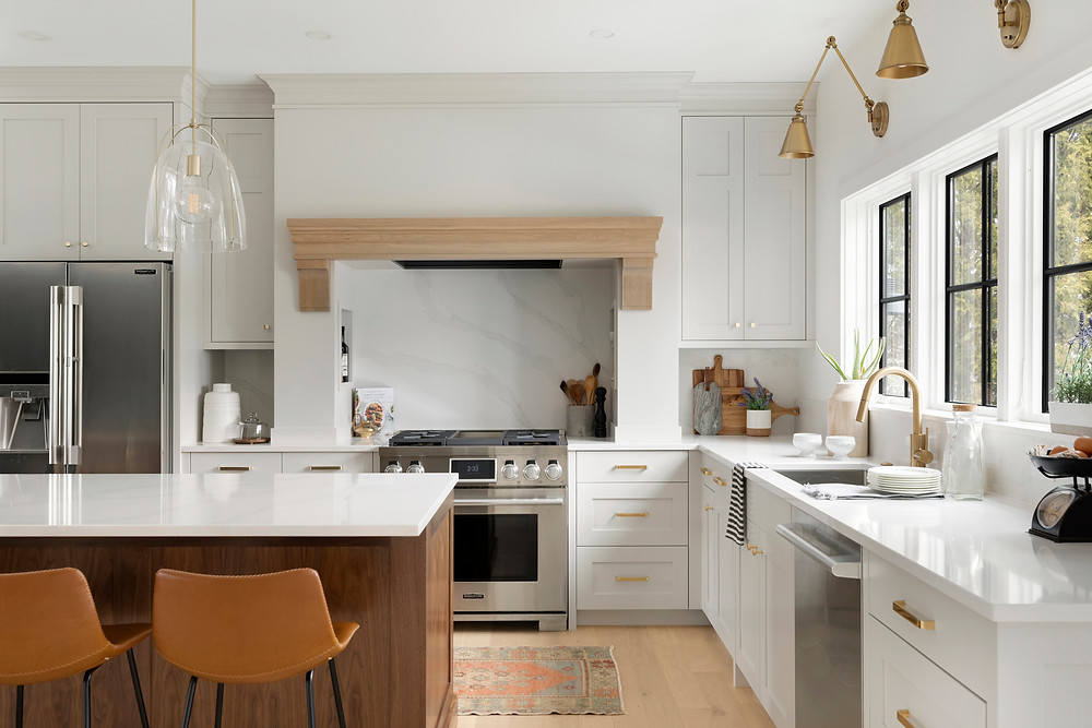 Balboa Mist kitchen cabinetry, gold fixtures, black windows.