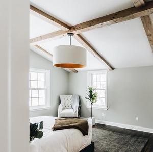 Vaulted reclaimed ceiling beams in en suite master bedroom
