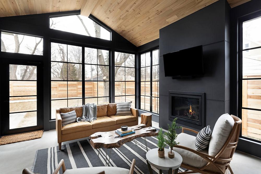 Screen porch, black walls, reclaimed wood ceiling.