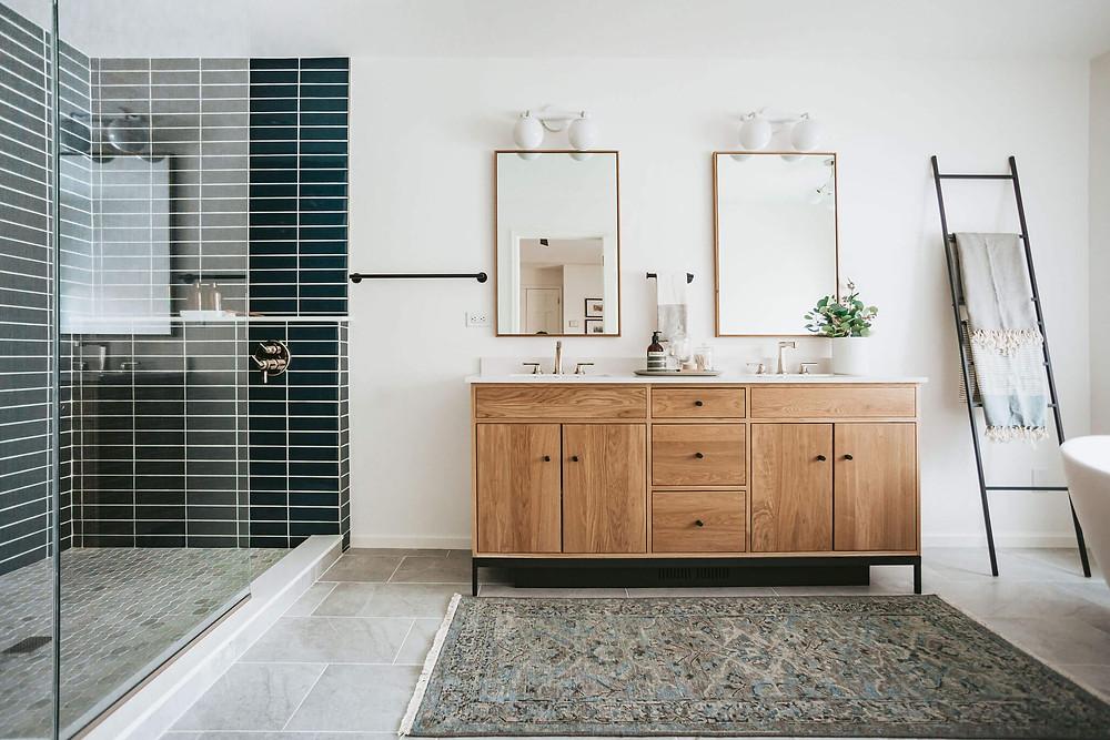 Owner's mid-century Scandinavian design en suite bathroom with walk-in shower, white oak double vanity and freestanding bathtub