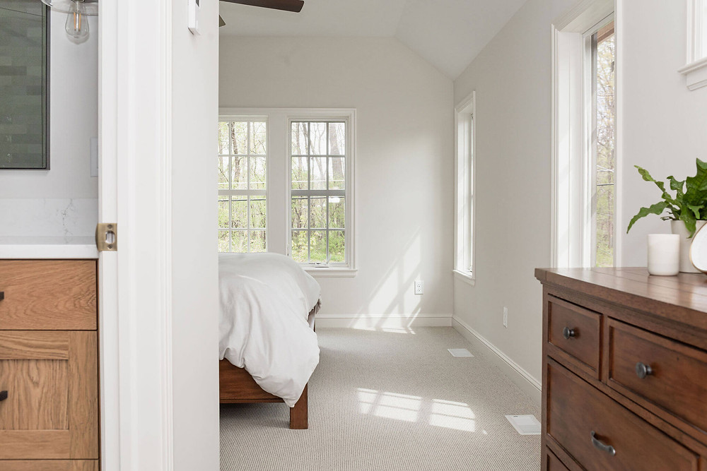 Primary owner's suite with large windows and bathroom