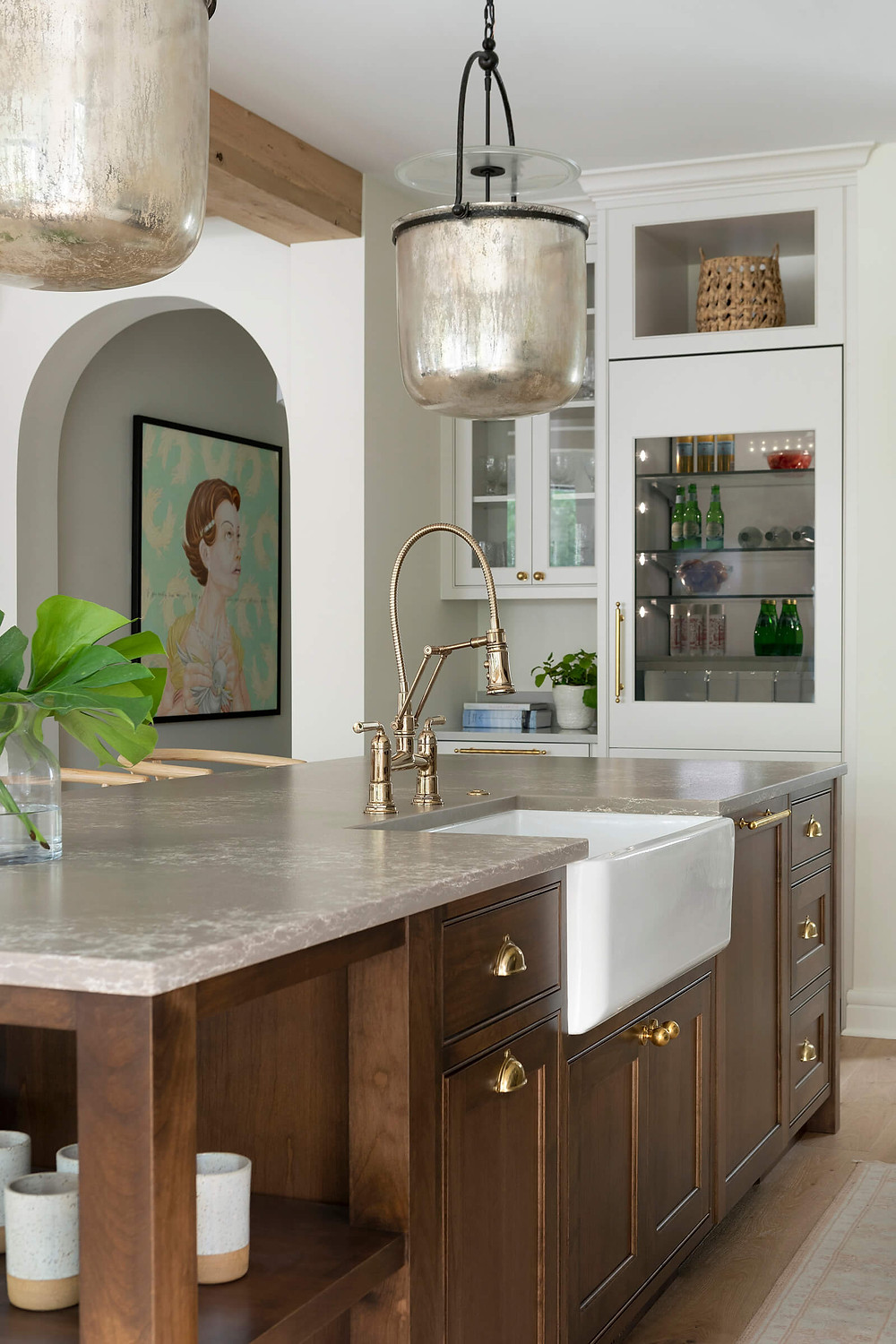 Modern traditional kitchen reveal, featuring warm wood tones, light pained cabinetry, unlacquered brass hardware and integrated appliances.