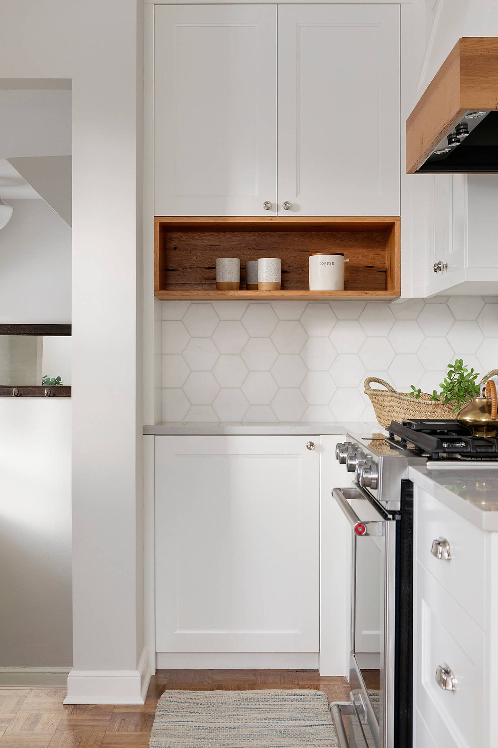 Our favorite kitchen niche designs. Featuring a custom coffee station for mugs, coffee grounds, and more.