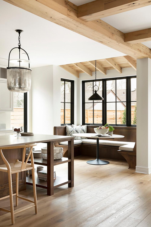 Reclaimed white oak beams, engineered white oak flooring and black windows