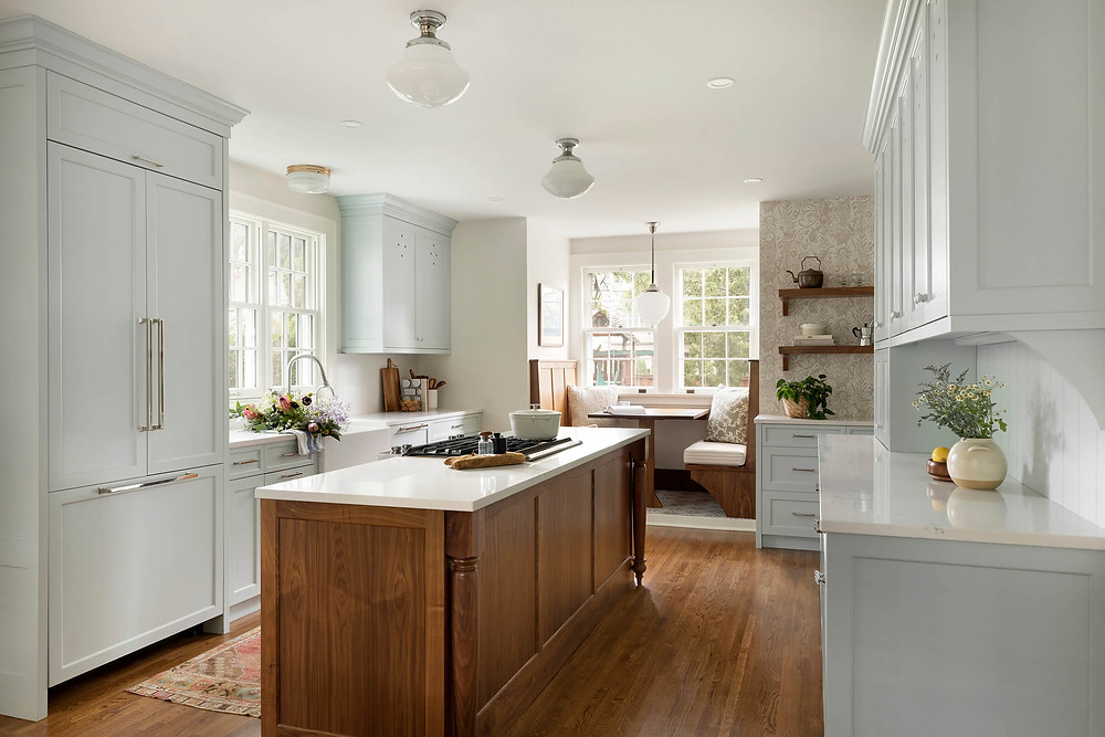 Charming Colonial modern traditional kitchen with integrated panel ready appliances, blue custom cabinetry and walnut island and vintage light fixtures