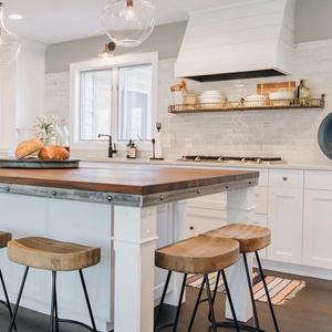 white kitchen artisan tile backsplash butcher block countertop range hood shiplap clear island pendants