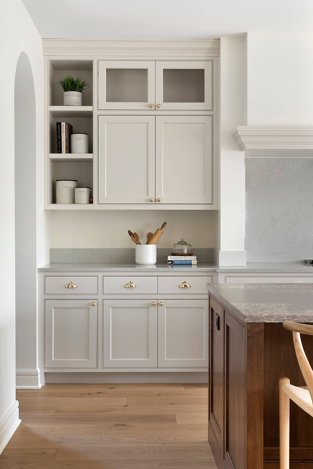 Custom inset kitchen cabinets in beautiful mushroom taupe beige paint with open shelf detail and engineered white oak flooring.