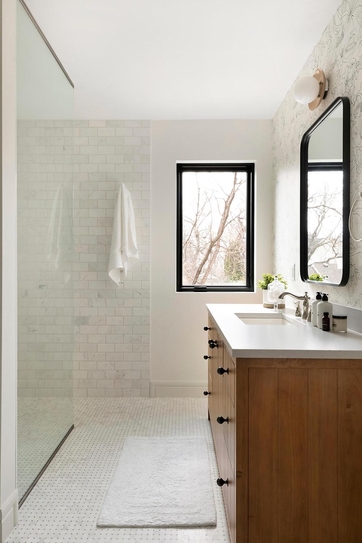 Jeffrey Court Metropolitan Mosaic floor tile, white subway marble tile and custom alder stained vanity.