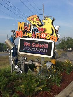 MELLOW MUSHROOM GROUND SIGN