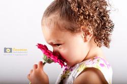 Photography child girl smells flower