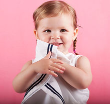 Photo cute toddler girl white dress smiling looking straight