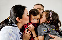 Family photo mom dad child girl kissing baby
