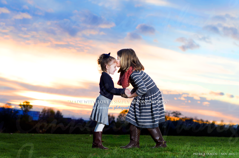 2 little girls sisters holding hands Sunset Fraser River Park Vancouver