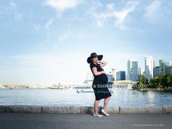 Femme enceinte robe noir bord eau