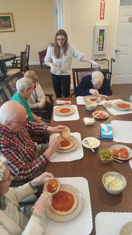 Legacy care residents making their own pizzas