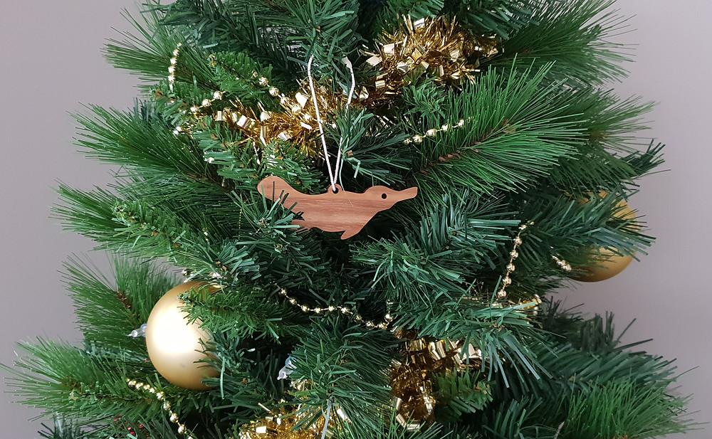 Wooden platypus ornament on Christmas tree