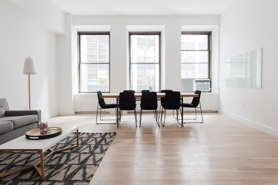 Dining and living room with geometric rug