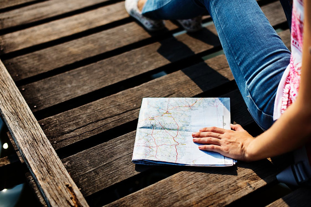 Traveller with map
