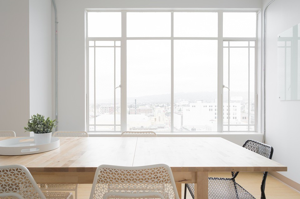 Light, bright dining room with large windows