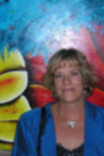 Painter Ank Draijer on her exhibition posing before one of her paintings