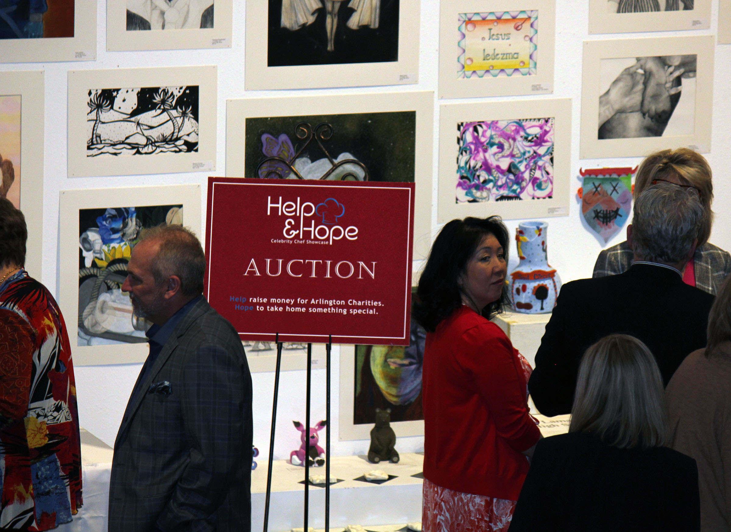 auction sign with crowd