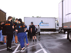 Arlington charities truck with people in