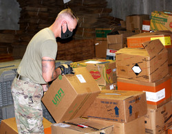 Guard picking up a box