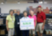 volunteers w. sign.jpg