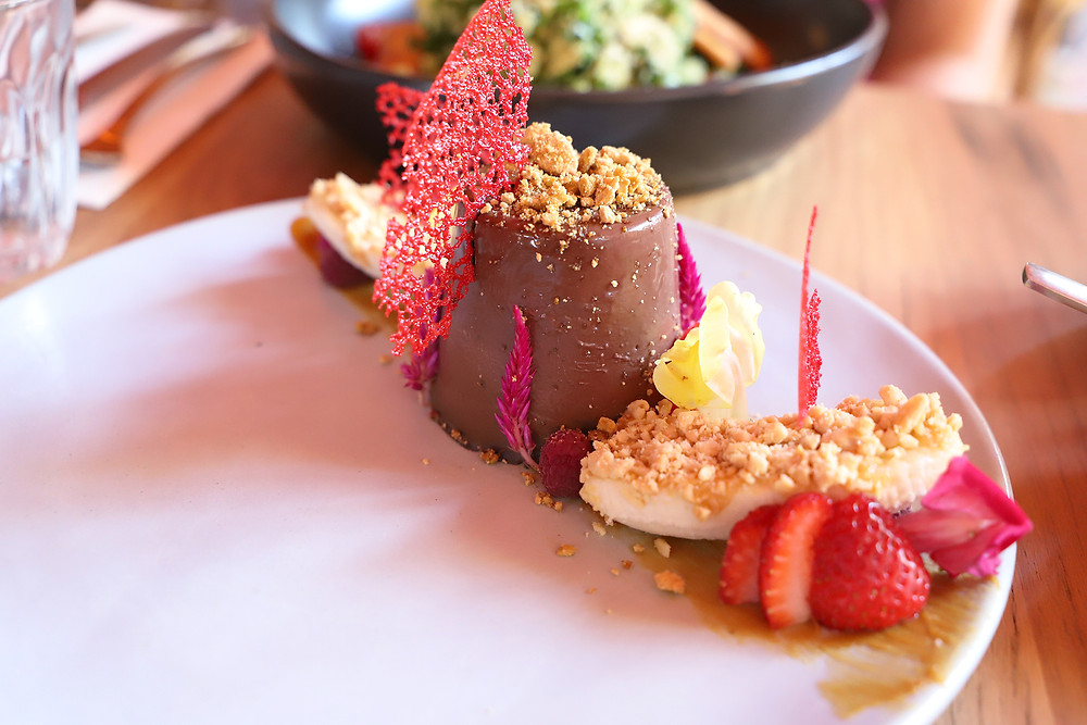 Golden Gaytime chocolate Panna Cotta from Bentwood cafe served on a white plate.