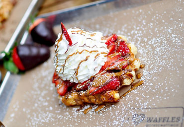 Our Bestseller! Freshly cut strawberries, cookie butter, Nutella, and our house made whipped cream on top of our golden Liége waffle.