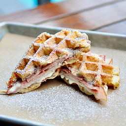 Waffle sandwich stuffed with blackforest ham, smoked turkey, melted white american cheese, and berry jam inside of our golden Liége waffle.