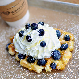 Tangy lemon curd, fresh blueberries, and our housemade whipped cream on top of our golden Liége waffle.