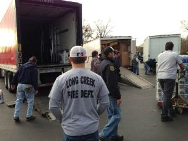 A truck being unloaded in NY