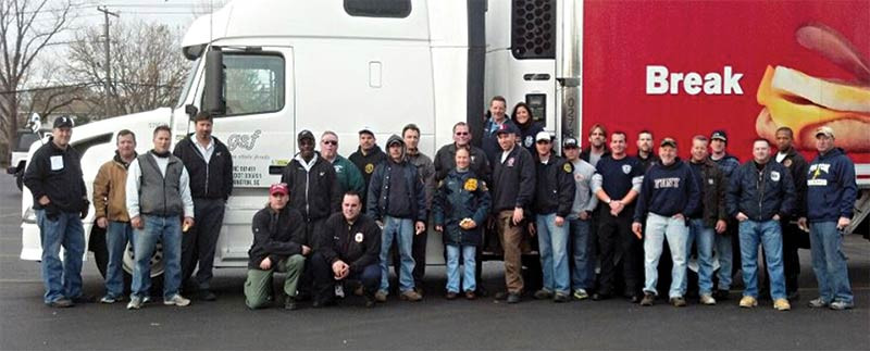 GSF associates and local firefighters pose for a group shot.