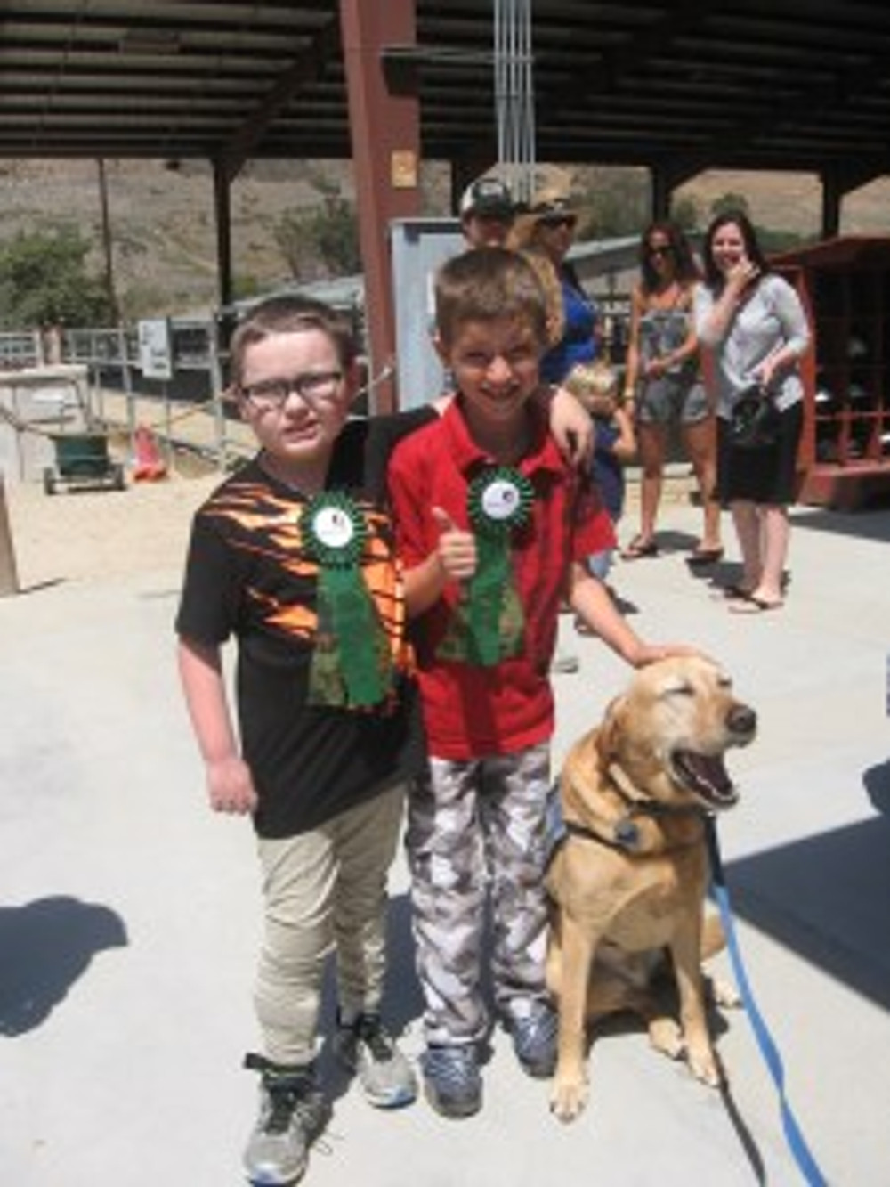 Deen (right) with his friend Cade and Emerson, the facility therapy dog