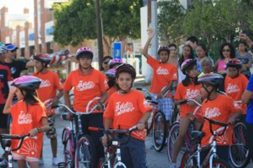 Excited children from Cabo San Lucas riding their bikes for the first time!