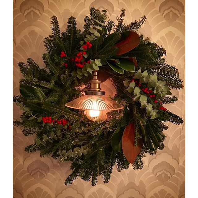 Holiday wreath of balsam, eucalyptus, magnolia and winterberry