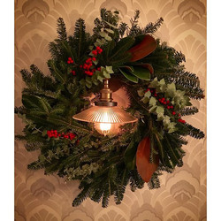 Holiday wreath of balsam, eucalyptus, magnolia and winterberry